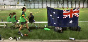 Team Australia raised their banner over the Subway Soccer Field. Photo: Phil Hossack, WFP.